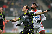 Bristol Rovers Tom Lockyer (4) waits for this one to come down watched by MK Dons Chuks Aneke(10) during the EFL Sky Bet League 1 match between Milton Keynes Dons and Bristol Rovers at stadium:mk, Milton Keynes, England on 3 March 2018. Picture by Nigel Cole.