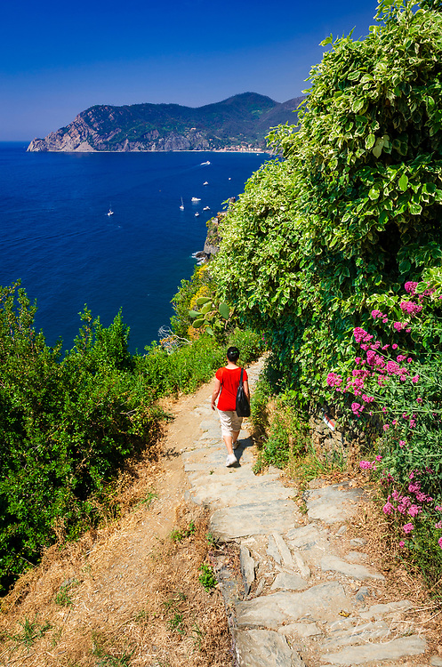 Woman on the Sentiero Azzurro (Blue Trail) near Vernazza, Cinque Terre, Liguria, Italy