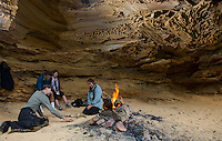 Evan Yanna Muru conducts ABORIGINAL BLUE MOUNTAINS WALKABOUT in the lower blue mountains of Faulconbridge. On the tour are Joe and Meg Boker from New Zealand and journalist Julica Jungehulsing. Evan explains dreamtime stories while topping for lunch at the bush cave on the walk.
