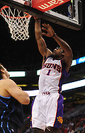 Mar. 19 2010; Phoenix, AZ, USA; Phoenix Suns forward Amare Stoudemire (1) puts up a shot in the first half at the US Airways Center.  The Suns defeated the Jazz 110-100. Mandatory Credit: Jennifer Stewart-US PRESSWIRE.