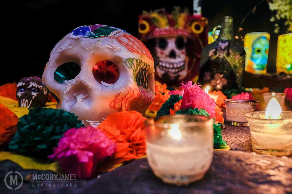 A sugar skull on an altar