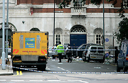 UK ENGLAND LONDON 7JUL05 - Bomb disposal experts walk through the site of a bus explosion in central London. At least two people have been killed and scores have been injured after at least seven blasts on the Underground network and a double-decker bus in London...jre/Photo by Jiri Rezac ..© Jiri Rezac 2005..Contact: +44 (0) 7050 110 417.Mobile:  +44 (0) 7801 337 683.Office:  +44 (0) 20 8968 9635..Email:   jiri@jirirezac.com.Web:    www.jirirezac.com..© All images Jiri Rezac 2005 - All rights reserved.