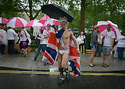 © Licensed to London News Pictures. 07/07/2012. London, UK Guests in the rain at the World Pride Procession in Central London today 7th July 2012. Despite reports of it's cancellation due to financial difficulty the scaled-down event went ahead after changes to its schedule. Photo credit : Stephen Simpson/LNP