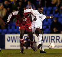 Photo. Jed Wee.<br /> Tranmere Rovers v Bristol City, Nationwide League Division Two, Prenton Park, Liverpool. 24/03/2004.<br /> Tranmere's Eugene Dadi (R) muscles his way to the ball ahead of Bristol's Clayton Fortune.