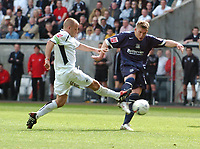 Photo: Adam Davies.<br />Swansea City v Southend United. Coca Cola League 1. <br />29/04/2006.<br />Southend's Freddy Eastwood is tackled by Swansea's Andy Robinson.
