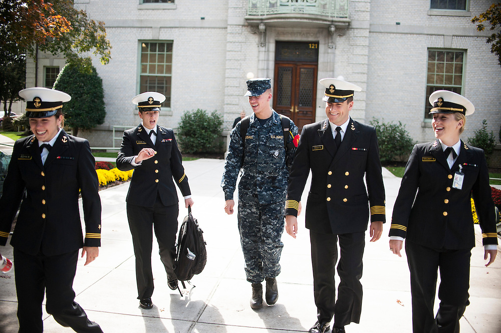 "photo by Matt Roth.Wednesday, October 17, 2012.Assignment ID: 3013301A..Naval Academy cadets (L-R)  Midshipman First Class Michaela ""Mikey"" Bilotta, straight, Midshipman Second Class Katherine ""Kay"" Moore, president of the Academy's chapter of Spectrum, a support organization for openly gay members of the military, Midshipman First Class Nicholas Bonsall. both openly gay, Brigade Commander Midshipman First Class Jonathan Poole, and Midshipman Phoebe Kotilkoff, both straight, walk to class in Annapolis, Maryland Wednesday, October 17, 2012 after participating in an interview with The New York Times discussing how the student body has handled the repeal of Don't Ask Don't Tell. The consensus points to a relatively wide spread acceptance of gay cadets among students on campus."