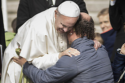 October 19, 2016 - Vatican City, Vatican - Pope Francis hugs a faithful during his Weekly General Audience in St. Peter's Square in Vatican City, Vatican. Pope Francis on Wednesday said access to food and water is a basic human right, and called on believers and people of good will everywhaere to take personal responsibility for the needs of their neighbors. (Credit Image: © Giuseppe Ciccia/Pacific Press via ZUMA Wire)