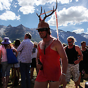 A race goer in fancy dress during the 50th Anniversary Glenorchy Race meeting. The races, which originally started in the 1920's, were resurrected in 1962 and have been run by local farmers and the rugby club on the first Saturday after New Years Day ever since. Glenorchy, Otago, New Zealand. 7th January 2012