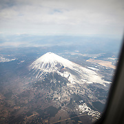 """CHIBA, JAPAN - JANUARY 27 : An areal view of Fuji Mountain during a tour flight to Kagoshima, Japan on January 27, 2017. Japan Airlines """"wan wan jet tour"""" allows owners and their dogs to travel together on a charter flight for a special three-day domestic tour to Kagoshima Prefecture, southwestern Japan. As part of the package tour, the owners and their dogs will also get to stay together in a hotel and go sightseeing in rented cars.  (Photo by Richard Atrero de Guzman/ANADOLU Agency)"""