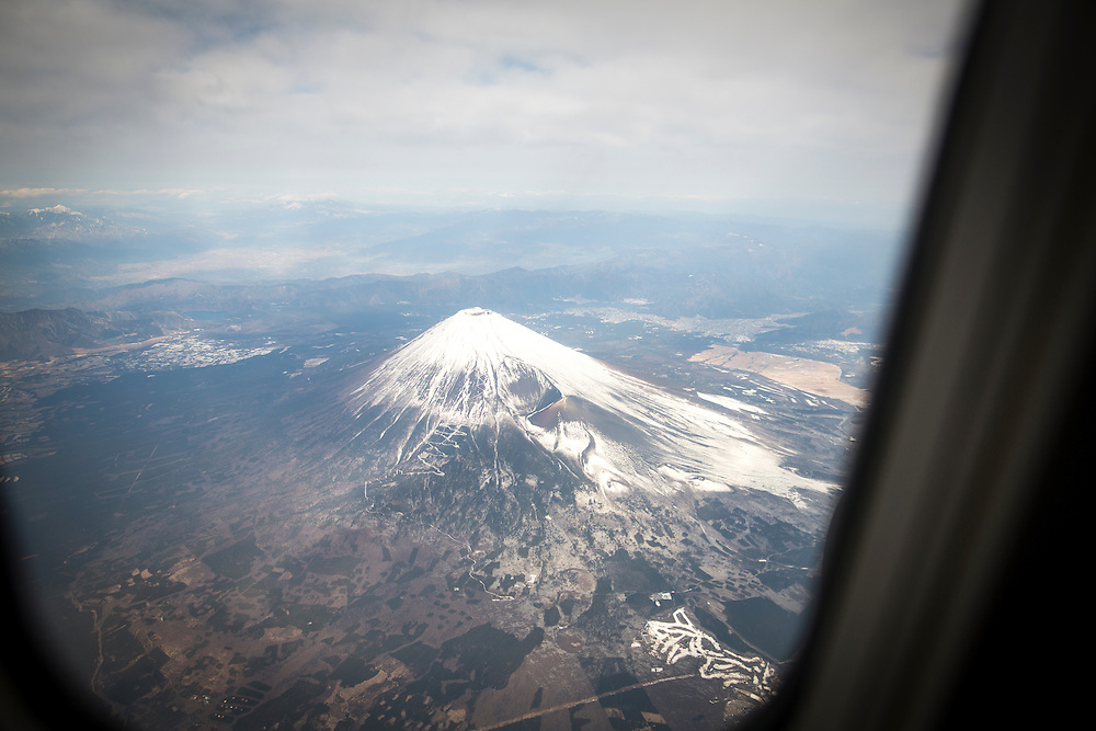 "CHIBA, JAPAN - JANUARY 27 : An areal view of Fuji Mountain during a tour flight to Kagoshima, Japan on January 27, 2017. Japan Airlines ""wan wan jet tour"" allows owners and their dogs to travel together on a charter flight for a special three-day domestic tour to Kagoshima Prefecture, southwestern Japan. As part of the package tour, the owners and their dogs will also get to stay together in a hotel and go sightseeing in rented cars.  (Photo by Richard Atrero de Guzman/ANADOLU Agency)"