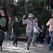 Dancing in Sha Tin Central Park. Every Tuesday a karaoke sound system is set up and people, mostly elderly woemn, gather to dance to the music. <br /> <br /> <br /> Hong Kong (香港; &quot;Fragrant Harbour&quot;), officially known as Hong Kong Special Administrative Region of the People's Republic of China since the hand-over from the United Kingdom in 1997 under the principle of &quot;one country, two systsems&quot;.  7 million people live on 1,104km square, making it the most vertivcal city in the world. Hong Kong is one of the world's leading financial centres along side London and New York, it has one of the highest income per capita in the world as well the moste severe income inequality amongst advanced economies. The Hong Kong civil society is highly regulated but has at the same time one of the most lassiez-faire economies with low taxation and free trade. Civil unrest and political dissent is unusual but in 2014 the Umbrella Movenment took to the streets of Hong Kong demanding democracy and universal suffrage. 93 % are ethnic Chinese, mostly Cantonese speaking.