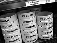 'I Love Guam' ashtrays for sale in a store in Tumon, Guam, on Saturday, Mar. 10, 2007.  Sometimes known as 'America in Asia', Guam is a popular destination for Japanese tourists ( accounting for approx 90% of the island's visitors) with average visitor numbers from Japan approaching 1million.  The island, a 3.5 hour flight from Japan, has more than 20 large hotels and numerous duty-free shopping malls catering to the Japanese tourists predilection for designer brand name goods, as well as golfing and other water based entertainment features. In 2007-2008 US military personal currently stationed in the Japanese Okinawan Islands will relocate their bases and operations  to Guam, helping to stabilise the island's economy which suffered after tourism decreased in recent years due to a  fear of flying by Japanese post 9-11 World Trade Centre disaster, a 2003 typhoon and the SARS disease outbreak in Asia.