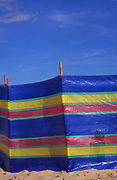AJDN86 Colourful windbreak and deep blue summer sky