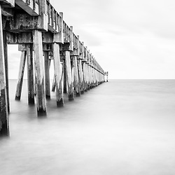 Pensacola Beach Florida Gulf Pier black and white photo. Pensacola Beach is on Santa Rosa Island in the Emerald Coast region of the Southeastern United States of America. Copyright ⓒ 2018 Paul Velgos with All Rights Reserved.