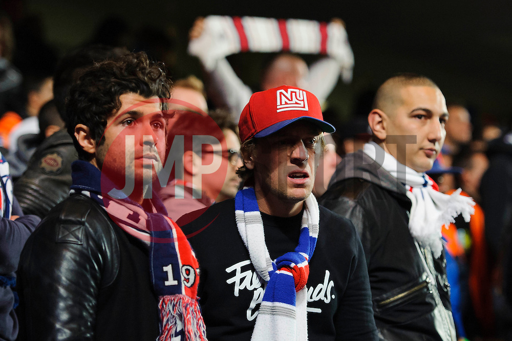 PSG fans look dejected after their side go out of the competition on away goals losing 2-0 on the night - Photo mandatory by-line: Rogan Thomson/JMP - 07966 386802 - 08/04/2014 - SPORT - FOOTBALL - Stamford Bridge, London - Chelsea v Paris Saint-Germain - UEFA Champions League Quarter-Final Second Leg.