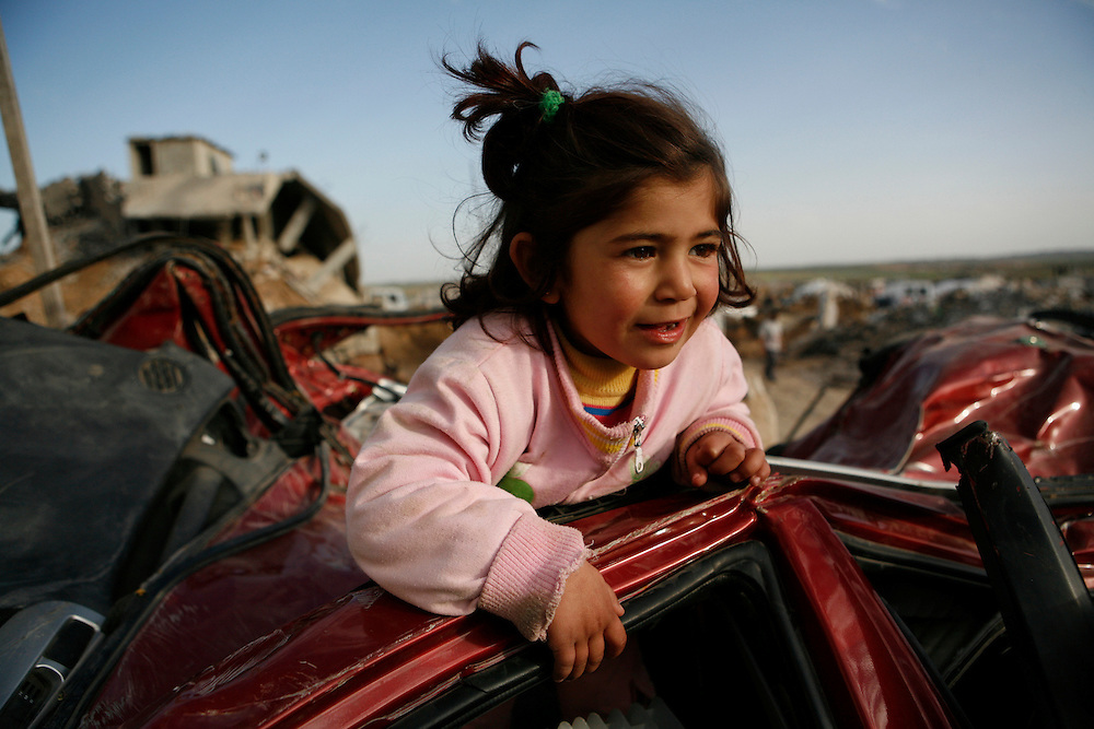 Palestinian children play in a destroyed car in the Gaza Strip.