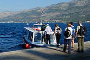 Tourists boarding Taxi boat, or water taxi. Island of Korcula, Croatia