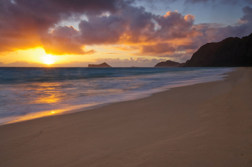 Waimanalo Bay Beach, Koolau Mountains and Rabbit Island at sunrise, Windward Oahu, Hawaii.