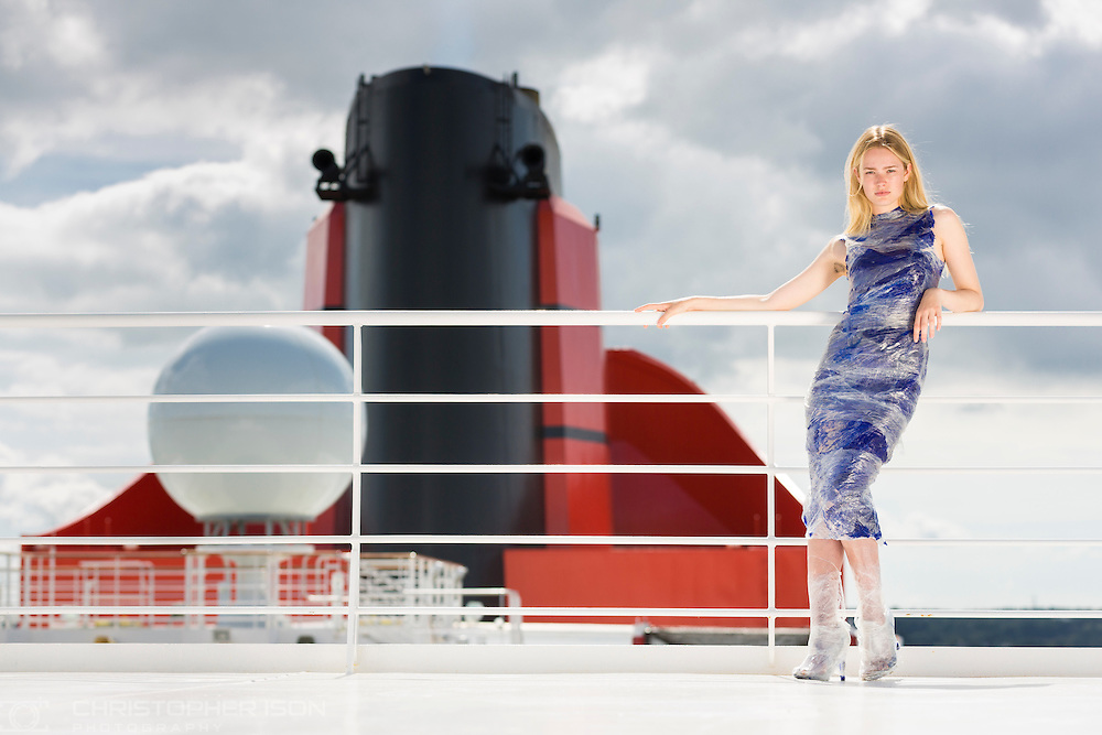 A Storm model wears an outfit designed by Royal College of Art graduate Stefanie Tschirky under the iconic funnel of Queen Mary 2 in Southampton today. Cunard's first Transatlantic Fashion Week voyage set sail from Southampton and will arrive in to New York City for the start of New York Fashion Week on the 8th September. <br /> Picture date: Thursday September 1, 2016.<br /> Photograph by Christopher Ison &copy;<br /> 07544044177<br /> chris@christopherison.com<br /> www.christopherison.com