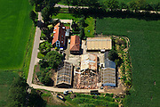 Nederland, Gelderland, Achterhoek, 30-06-2011; omgeving Lochem.De stallen van een boerderij bij Lochem worden gerenoveerd en voorzien van nieuwe daken. Renovation of the roofs of stables of a farm. .luchtfoto (toeslag), aerial photo (additional fee required).copyright foto/photo Siebe Swart