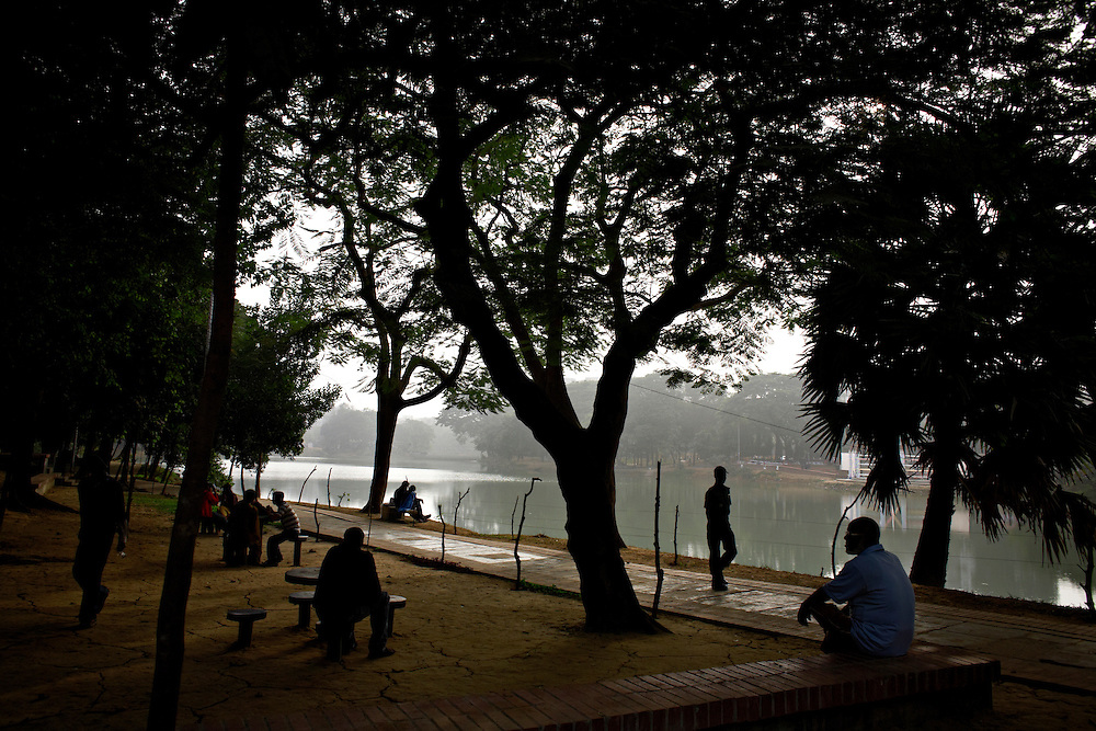 People by the Dhanmondi Lake, Dhaka, Bangladesh..A peaceful place, where young couples spend time together in public to get to know eachoter, while hiding in public from their families...Bangladesh has finished with two years of emergency rule. The election results is compared to the landslide of 1970 that led to war and independence from Pakistan. .When preparations for the election started in late 2006, violent street-protests started, and led to a military backed interim government until the election happened under heavy security and watchful eyes on December 29th 2008...The past two years have seen a decrease of crime and corruption but also sparked violent student protests and curfews. Today  most people seem to be happy to return to some sort of normality. But in one of the poorest countries in the world where 80% live for less than a dollar a day, does it really matter who is in power? The circus is over, back to reality and putting food on the table...A blogger  from dhaka is quoted Ó we prefer messy democracy to military ruleÓ...Is this the end of night, a new dawn or yet another dusk?..Photo by: Eivind H. Natvig/MOMENT *** Local Caption ***