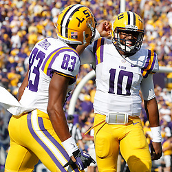 Oct 12, 2013; Baton Rouge, LA, USA; LSU Tigers quarterback Anthony Jennings (10) celebrates after scoring a touchdown against the Florida Gators during the second quarter of a game at Tiger Stadium. Mandatory Credit: Derick E. Hingle-USA TODAY Sports