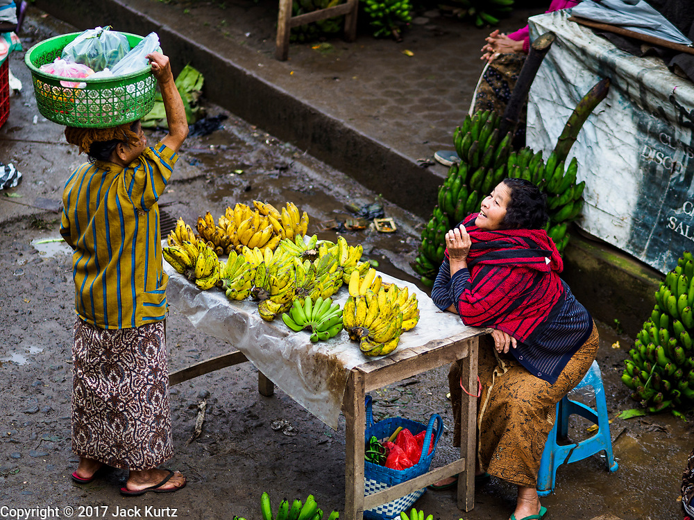 04 AUGUST 2017 - PAYANGAN, BALI, INDONESIA: A banana vender in the local market in Payangan, about 45 minutes from Ubud. Bali's local markets are open on an every three day rotating schedule because venders travel from town to town. Before modern refrigeration and convenience stores became common place on Bali, markets were thriving community gatherings. Fewer people shop at markets now as more and more consumers go to convenience stores and more families have refrigerators.      PHOTO BY JACK KURTZ