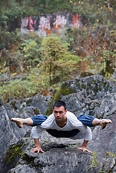 November 20, 2018 - Guang'an, China - A man practices yoga in front of waterfall at Huaying Mountain in Guang'an, southwest China's Sichuan Province. (Credit Image: © SIPA Asia via ZUMA Wire)
