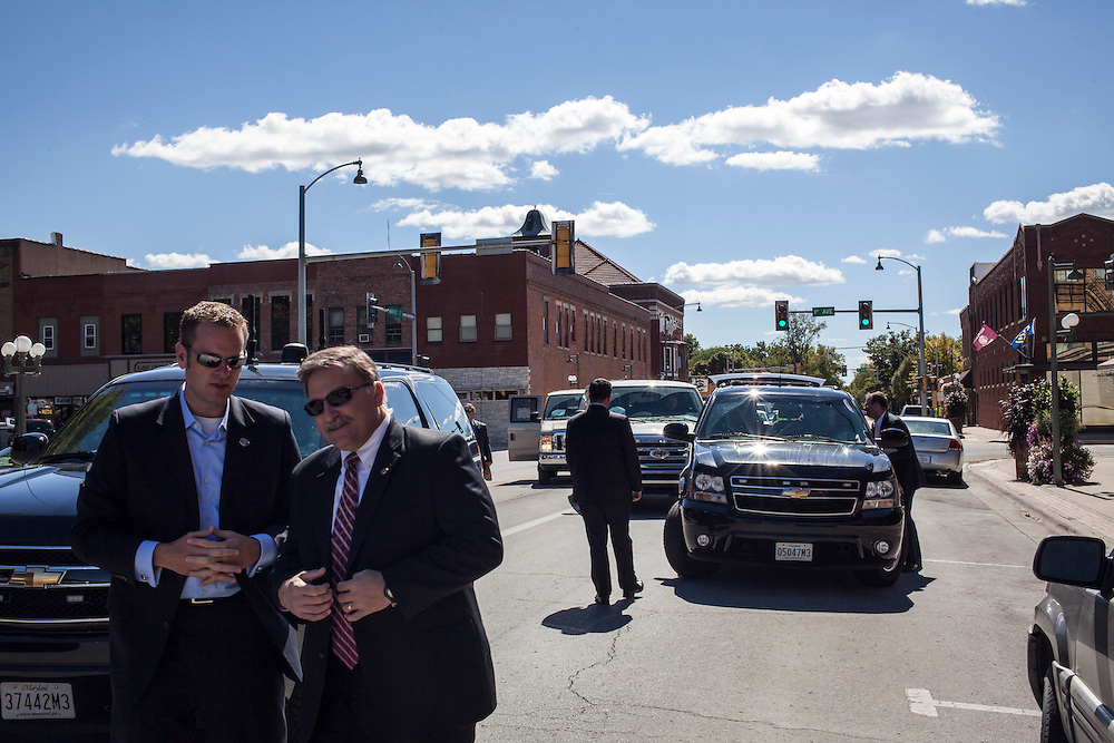 Vice President Joe Biden's motorcade is parked in the street as he makes an unscheduled stop at Smokey Row Coffee during a two-day campaign swing through Iowa on Tuesday, September 18, 2012 in Oskaloosa, IA.