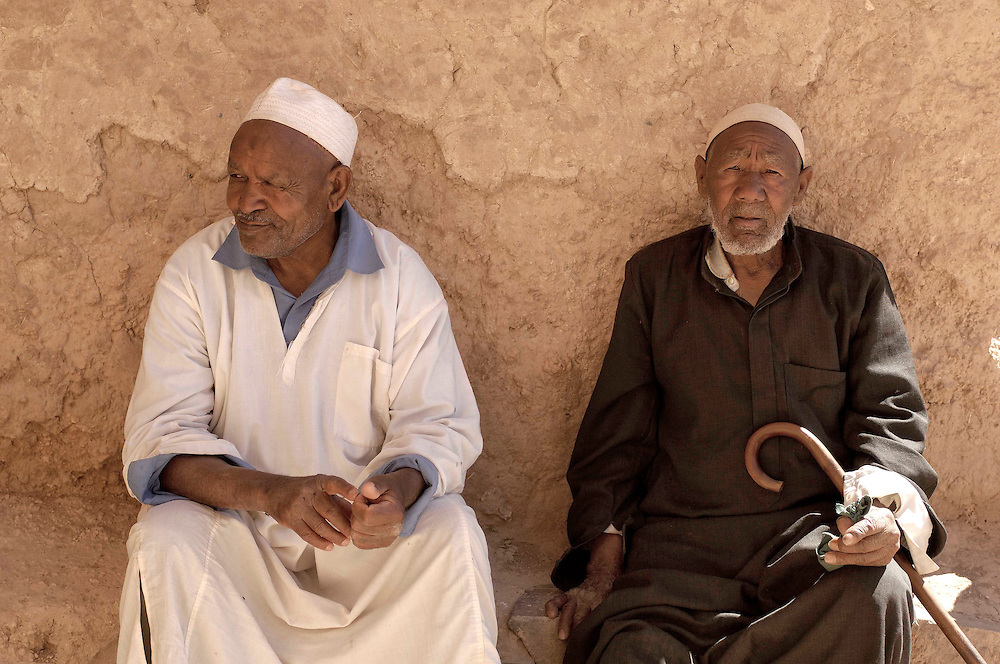 Old men sitting at Ksar Tinejdad, Morocco