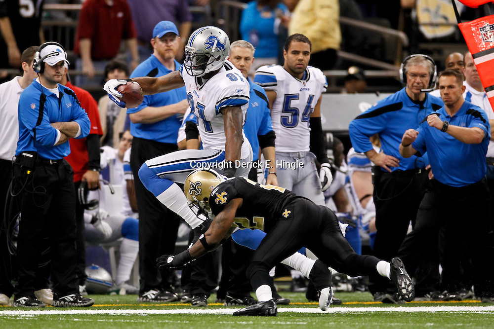 January 7, 2012; New Orleans, LA, USA; Detroit Lions wide receiver Calvin Johnson (81) is pursued by New Orleans Saints cornerback Tracy Porter (22) during the 2011 NFC wild card playoff game at the Mercedes-Benz Superdome. Mandatory Credit: Derick E. Hingle-US PRESSWIRE
