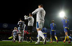 Queens Park Rangers and Leeds United walk out onto the pitch ahead of the match