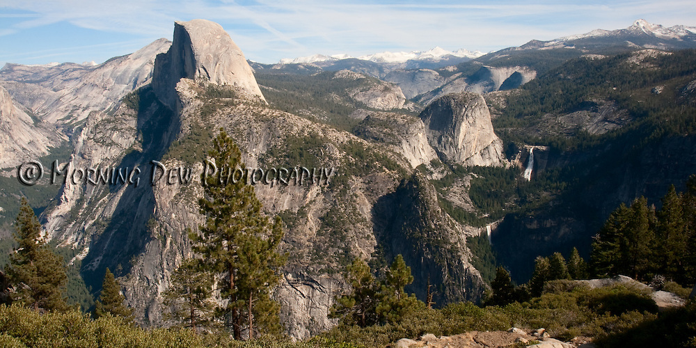 This view of Yosemite National Park features the iconic Half Dome, Vernal and Nevada Falls and the high Sierras.