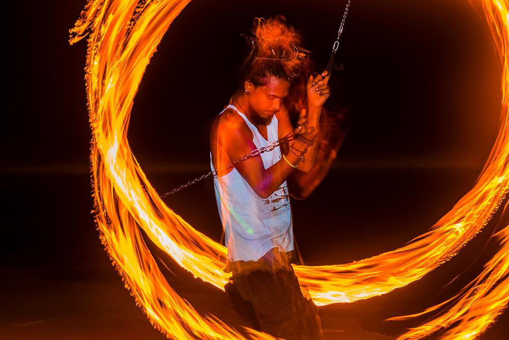 Fire dancer twirling fire, Mirissa Beach, south coast of Sri Lanka.