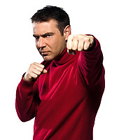 caucasian man boxing gesture studio portrait on isolated white backgound