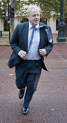 © Licensed to London News Pictures. 15/11/2017. London, UK.  Foreign Secretary Boris Johnson sprints across The Mall as he heads to Whitehall ahead of a meeting with Richard Ratcliffe. Mr Ratcliffe's wife, Nazanin Zaghari-Ratcliffe, is currently serving a five-year prison sentence after being arrested at Tehran airport in April 2016 as she attempted to return home from a visit to see her family. Her sentence may be increased after Foreign Secretary Boris Johnson mistakenly said she was in Iran to train journalists. Photo credit: Peter Macdiarmid/LNP