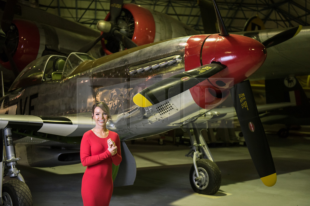 © Licensed to London News Pictures. 21/11/2018. London, UK.  <br /> TV presenter and Strictly Come Dancing star Katie Piper poses for a photograph in front of a P-51 Mustang aircraft in the Royal Air Force Museum London to launch the National Lottery's Thanks To You campaign in London, England on November 21, 2018. The Thanks To You promotion which runs from December 3 until December 9 sees venues, which have received Lottery funding, offering free offers and/or free entry to people in possession of a National Lottery ticket. Some of the UK's best-loved venues will be taking part, including: the Natural History Museum, Science Museum, Kew Gardens, Eden Project, Jodrell Bank, the National Railway Museum, V&A Dundee, National Museum Wales and over 100 National Trust sites.  Photo credit: Oli Scarff/LNP