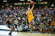 Vermont's Cam Ward (14) leaps for a lay up during the men's basketball game between the Lyndon State Hornets and the Vermont Catamounts at Patrick Gym on Saturday afternoon November 19, 2016 in Burlington (BRIAN JENKINS/for the FREE PRESS)