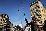 Hosni Mubarak forces wielding whips and on horseback disrupt a front of anti-government protesters in Tahrir Square in Cairo, Egypt on January 3, 2011. Egypt erupted in mass protests on Jan. 25, 2011 with protesters demanding President Mubarak step down from power, chanting that they will not leave Tahrir Square until Mubarak leaves office. Mr. Mubarak has said he will not run for reelection but has refused to step down from power, and has sent his armed supporters to violently attack the crowds of protesters. Human rights organizations report that at least 150 people have been killed since the protests began.