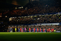referee Michael Oliver leads out the Chelsea and Liverpool sides at the start of the match - Photo mandatory by-line: Rogan Thomson/JMP - 07966 386802 - 27/01/2015 - SPORT - FOOTBALL - London, England - Stamford Bridge - Chelsea v Liverpool - Capital One Cup Semi-Final Second Leg.