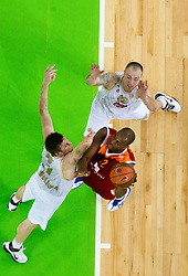 Vladimer Boisa of Olimpija and Damir Markota of Olimpija vs Ali Traore of Lottomatica during basketball match between KK Union Olimpija (SLO) and Lottomatica Roma (ITA) in Group F of Top 16 Turkish Airlines Euroleague, on February 23, 2011 in Arena Stozice, Ljubljana, Slovenia. Lottomatica defeated 87-76. (Photo By Vid Ponikvar / Sportida.com)