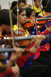 Members of the Venezuelan Youth Orchestra  play a concert for their guests, the New England Youth Orchestra .  The Venezuelan Youth Orchestra is part of a music program, that encompasses more than 200,000 Venezuelan youth.  The program is meant to help underprivileged youth.
