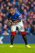 Alfredo Morelos (#20) of Rangers FC holds his injured wrist during the Ladbrokes Scottish Premiership match between Rangers FC and Heart of Midlothian FC at Ibrox Park, Glasgow, Scotland on 1 December 2019.