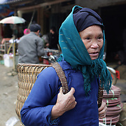 A visitor to the Lung Khau Nhin Market. Vietnam. Lung Khau Nhin Market is rural tribal market hiding itself amongst the mountains and forests of the far north Vietnam about 10 km from the border with China. The market plays an important role for the local ethnic people, Flower Hmong, Black Zao, Zay, and very small ethnic groups  Pa Zi, Tou Zi, Tou Lao. Tourist trips to the market run from Sapa and Lao Cai every week. Lung Khau Nhin Market, Vietnam.15th March 2012. Photo Tim Clayton