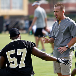 May 31, 2012; Metairie, LA, USA; New Orleans Saints defensive coordinator Steve Spagnuolo talks with linebacker David Hawthrone (57) during organized team activities at the team's practice facility. Mandatory Credit: Derick E. Hingle-US PRESSWIRE
