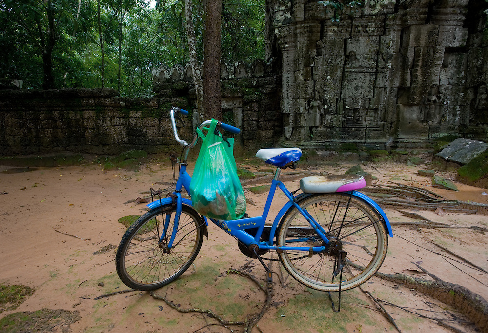 A local's bicycle sits in a temple yard.