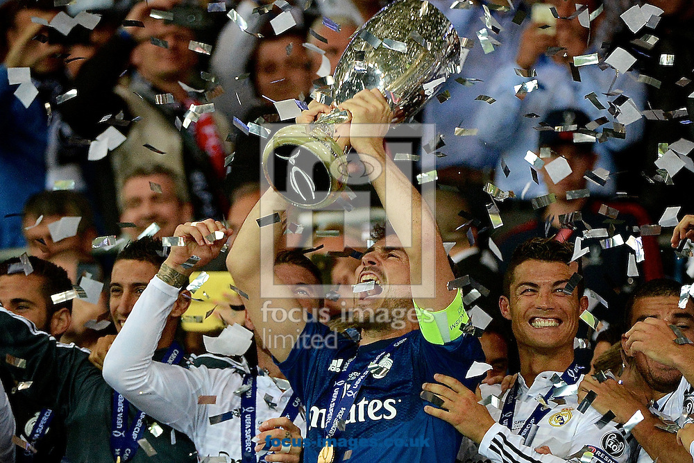 Iker Casillas of Real Madrid lifts the trophy following the European Super Cup match at the Cardiff City Stadium, Cardiff<br /> Picture by Ian Wadkins/Focus Images Ltd +44 7877 568959<br /> 12/08/2014
