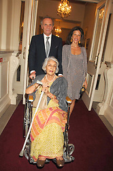 MARK & CLEO SHAND with The RAJMATA OF JAIPUR at a party to celebrate the launch of the 'Inde Mysterieuse' jewellery collection held at Lancaster House, London SW1 on 19th September 2007.<br />