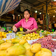 Stallholder at <br /> Ya Ma Tei Fruit Market, Hong Kong
