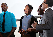 From left: Julius Smiley, Lorne Owens, Kari M. Curry, and Jeffrey Billingslea give a vocal performance during the first-ever Men of Black Excellence Awards at Ohio Univesity, held on April 13, 2014, in Walter Rotunda. The ceremony recognized African American students in categories such as academics, campus involvement, and the performing arts, among others, and featured keynote speaker Aaron Jeter. Photo by Lauren Pond